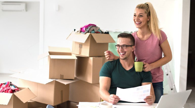 Couple in room with moving boxes