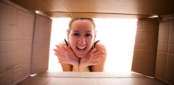 Girl in front of the open moving box