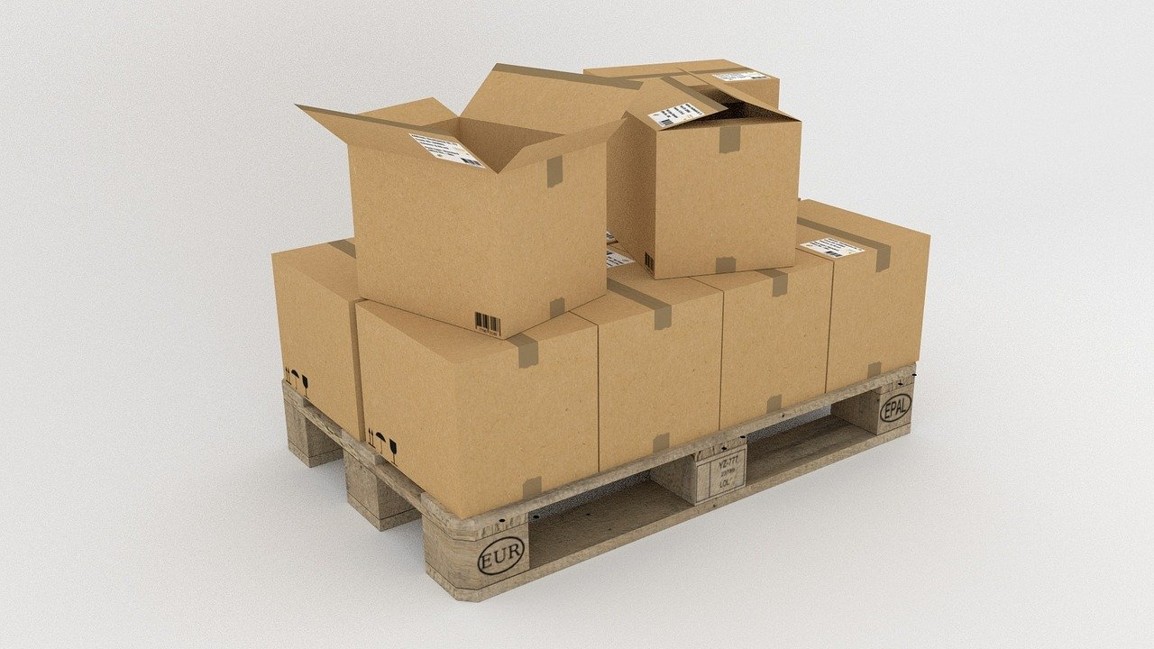 Professional furniture movers have the right equipment - quality moving boxes on palletes.