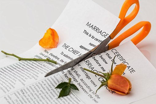 Cutting off wedding paper after divorce helps a lot of people to take out the stress during relocation