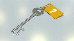 Key with orange question mark tag.