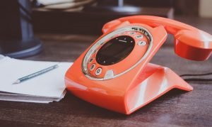 Orange dial-up phone - one call it all it takes for our Pembroke Pines movers to take care of everything.