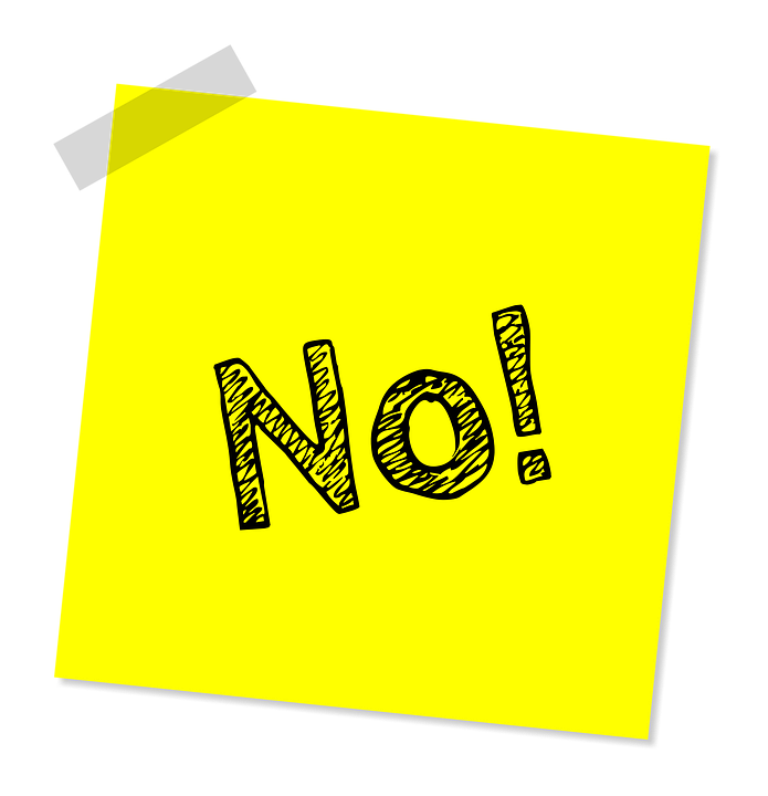 A yellow post it note with the word no written on it. Learn what not to put in your storage unit in order to make your relocation easier.