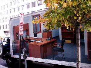 Relocation truck with image of office on it - our North Miami movers handle commercial moves as well.