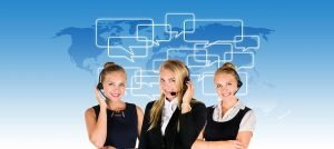 Three women from a call center with a blue background