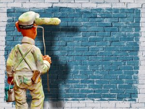 A man painting a wall.