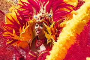 A woman dressed for a carnival.