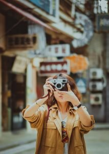 A woman with a camera - you will rarely see this if you avoid Miami tourist traps.