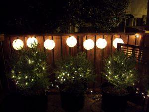Backyard lanterns on the fence