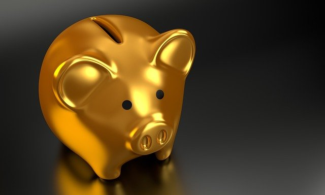 Gold piggy bank to save money on your office move.