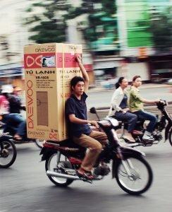 A way to move a refrigerator on a bike
