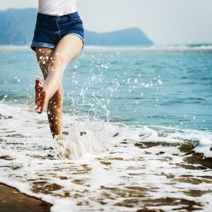 A woman walking on the beach.
