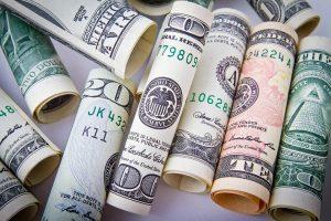 rolled up dollar bills