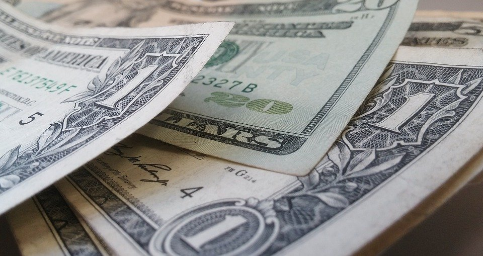 Dollar bills can help decide whether hiring movers vs DIY move is better