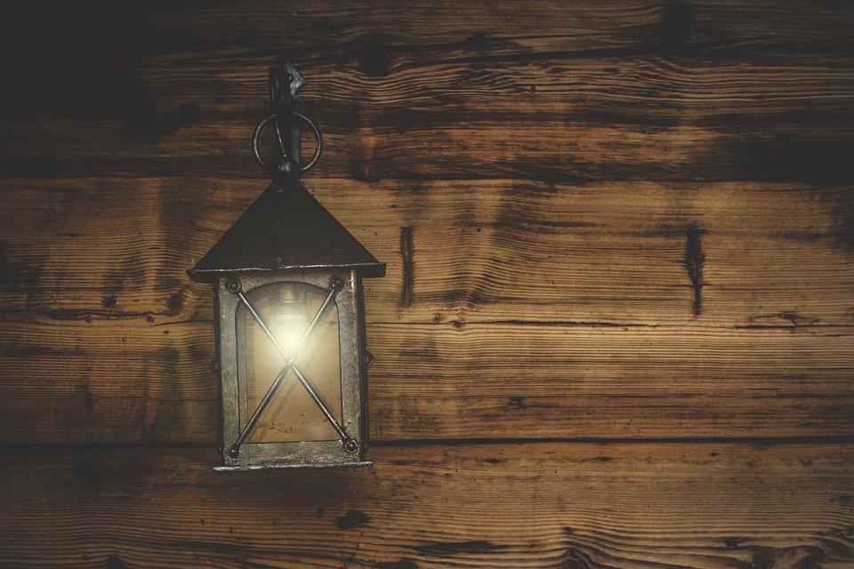Lantern on the wall as backyard lighting