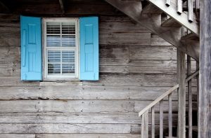 A blue window shutter to help you hurricane proof your house.