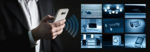 A man with a smart home, which is one of the best luxury home upgrades.