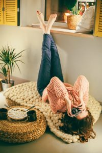 Increase the comfort of your home - woman on the blanket taking picture upside down