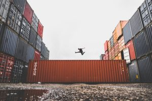 Portable storage company - man jumping on a container
