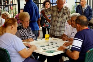 Locals playing dominoes at Calle Ocho