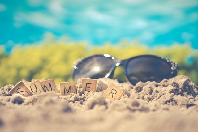 sand and sunglasses, a hint of what to expect when moving to a warmer climate