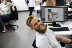 A man smiling in the office
