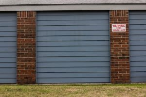 storage units with a sign showing video surveillance