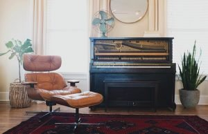 a piano and a chair in apartment