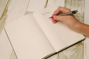 A person writing their plan