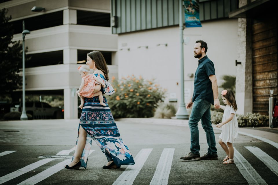 woman with family walking down the street