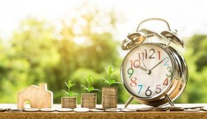 Money and alarm clock - time and money are important when moving in with your partner