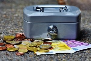 A money box with paper money and coins