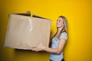 A woman holding long distance DIY relocation packing supplies