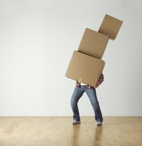 A man carrying moving boxes.