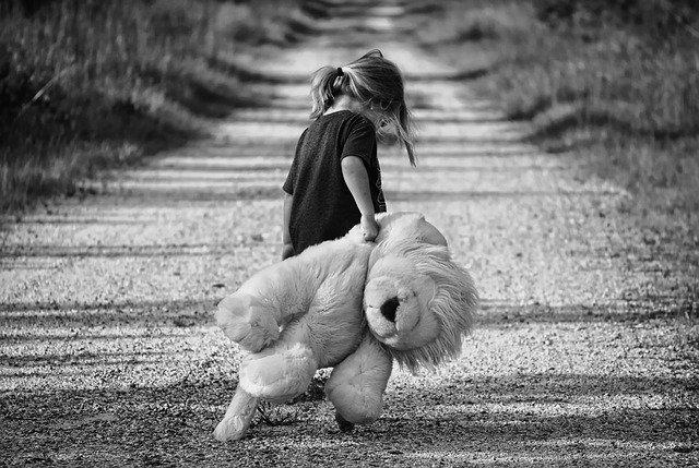 Girl moving a teddy bear alone