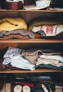 folded clothes in a cabinet