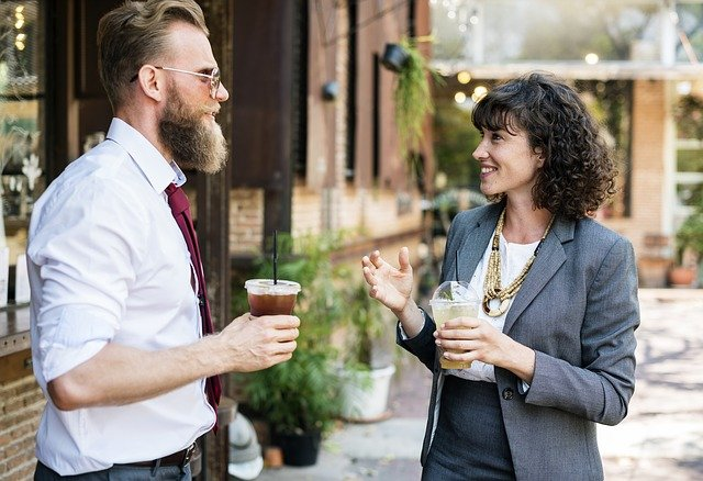 Man and woman talking as a way of meeting new neighbors