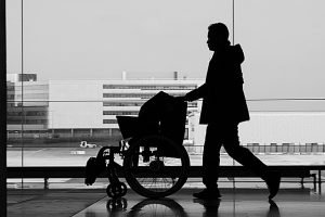Airport staff pushing wheelchair to help an elderly parent move